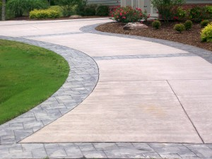 refinished concrete driveway with decorative stamped pavers