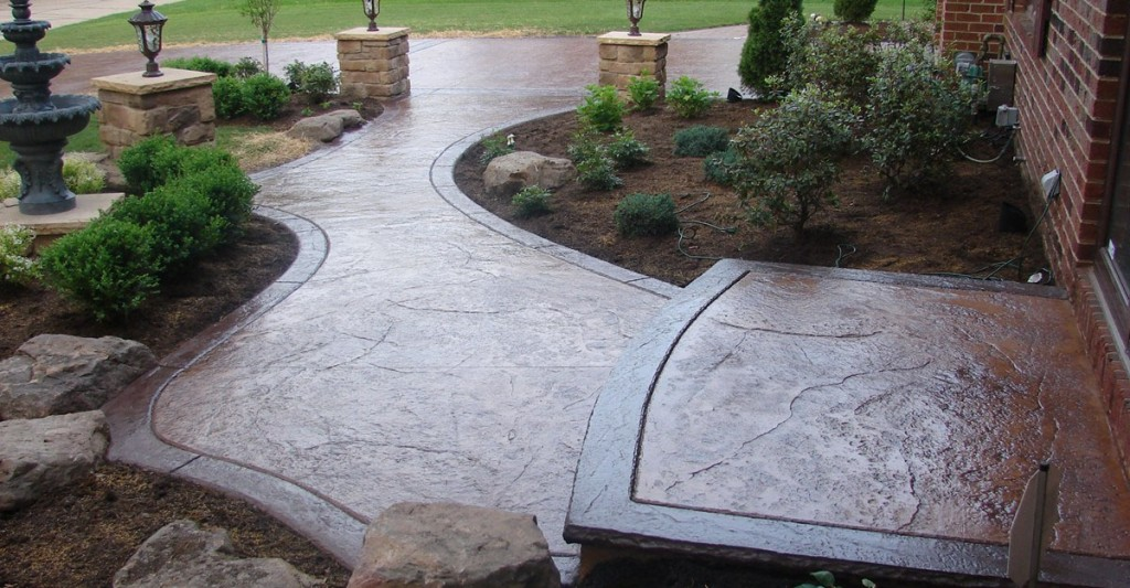 Brown and gray stamped concrete pathway